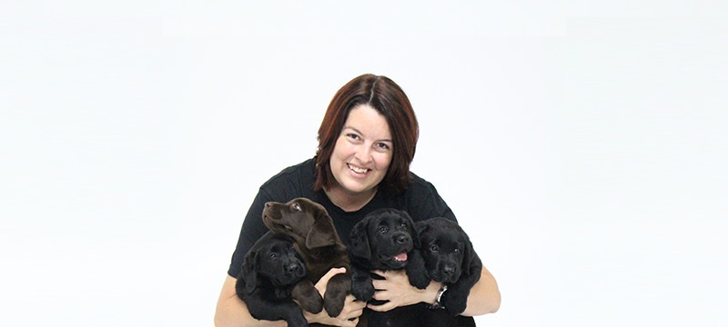 Alex Cearns with puppies