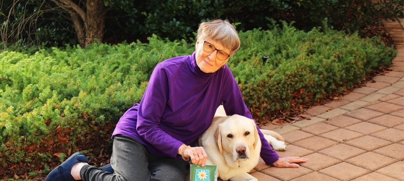 Sponsor Thelma with yellow labrador