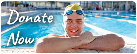 Jeremy holds himself out of the pool, resting on his arms and smiles at the camera. Text: Donate now