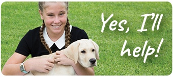 Tegan smiles at the camera as she cuddles Guide Dog Puppy Cheezel. Text: Yes, I'll help!