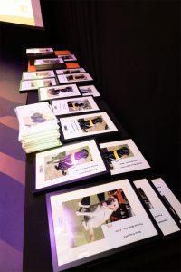 Framed Photos & Clay Plaques Awaiting Presentation