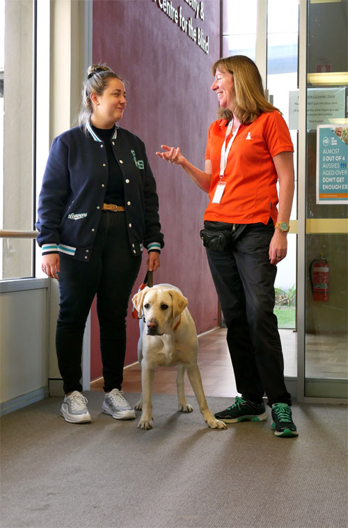 Guide Dog Mobility Instructor & Workshop Attendee With Guide Dog in Training