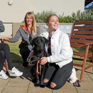 Tegan with trainee Guide Dog Loui and trainer Katie