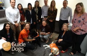 2019 Corporate Challenge Winners, Rio Tinto Accepting the Corporate Challenge Trophy with Ambassador Dog Annie