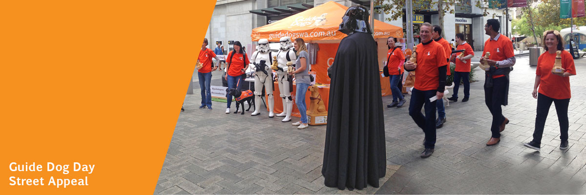 Volunteers and Star Wars characters at the Guide Dog Day Street Appeal