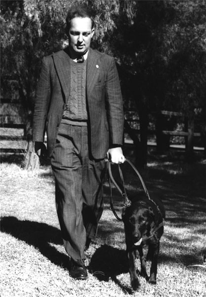 Dr Arnold Cook with Guide Dog Drena