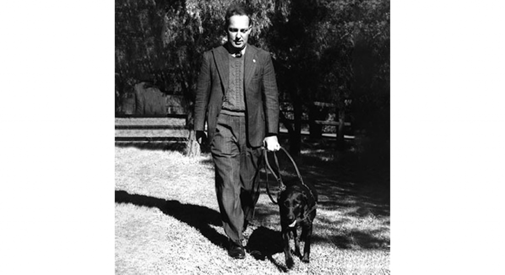 Dr Arnold Cook with black labrador Dreena