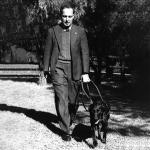Dr Arnold Cook with black labrador Dreena