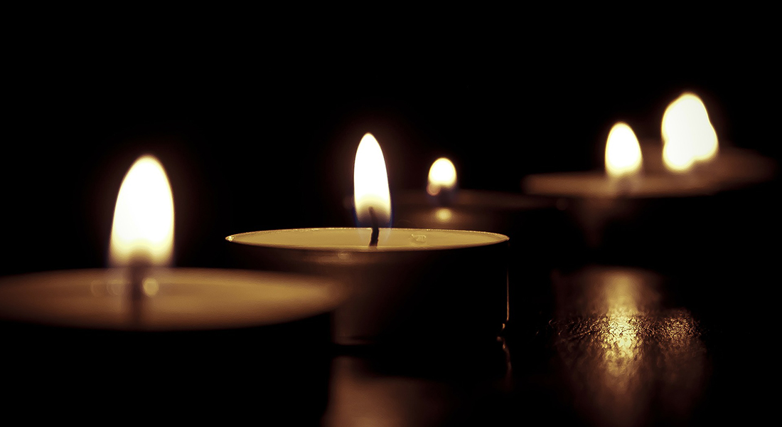 Candles against a black background.