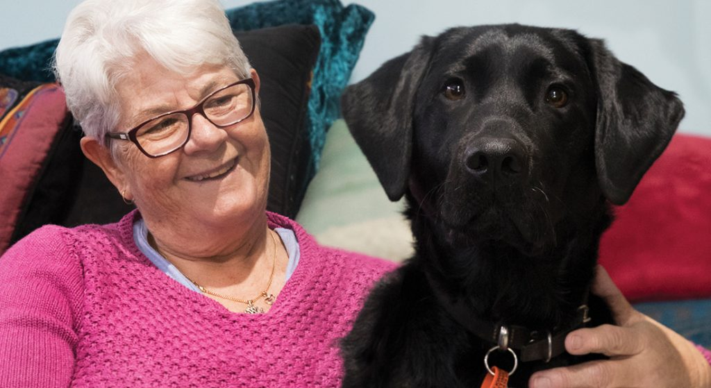 Close of a woman with her black labrador - Guide Dog Bella
