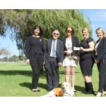Attendees of memorial ceremony with Ambassador Dog Gidgee