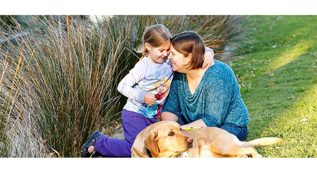 Amy with daughter Eleanor with Guide Dog Mena