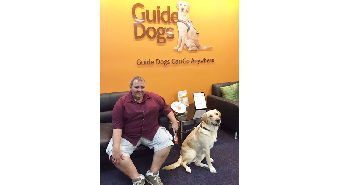 Volunteer Gino with Ambassador Dog