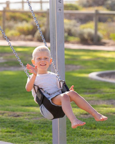 Wesley playing on a swing