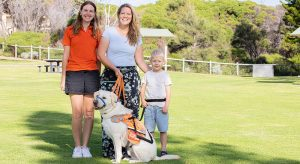 Wesley with AAD Max, mum Paige and trainer Victoria