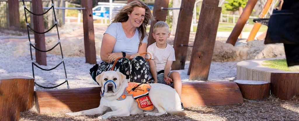 Wesley with mum Paige and Autism Assistance Dog Max