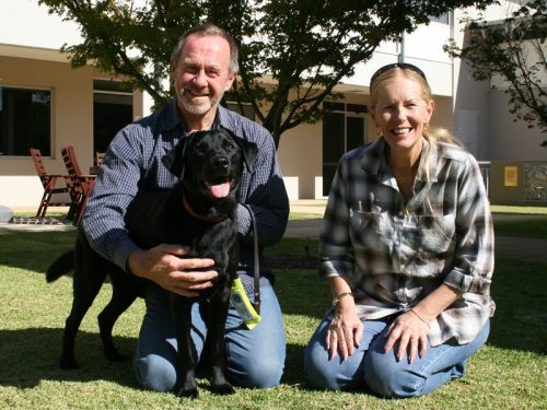 Guide Dog in training Cali with puppy raiser and sponsor